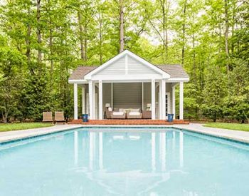 Outside pool house addition and remodel by Blue Heron Construction